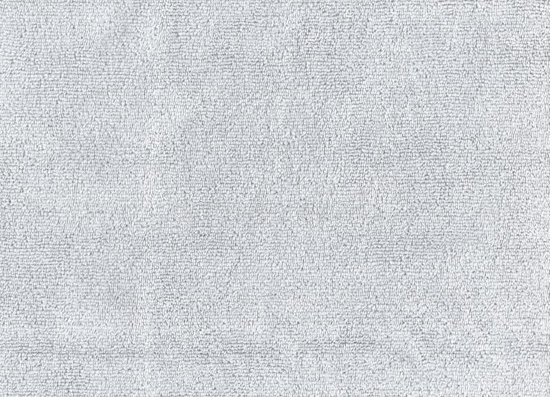 Closeup Grey color cleaning rag microfiber cloth background.Detail sample clean fabric texture backdrop.  royalty free stock photography