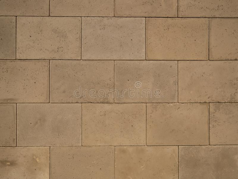Closeup of grey concrete block wall pattern background royalty free stock image