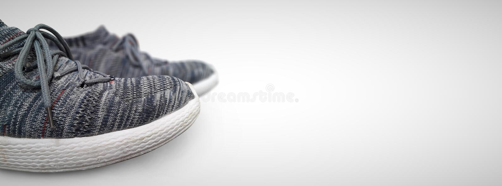 Closeup of grey fashion sports shoes isolated in white background wide photo.  royalty free stock photo
