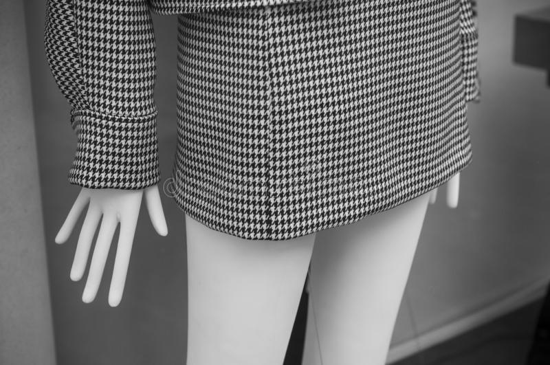 grey houndstooth skirt on mannequin in fashion store stock photography