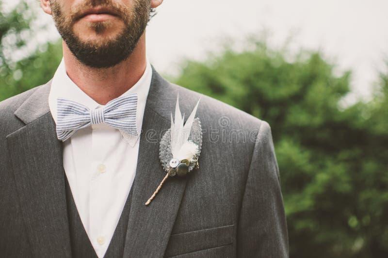 Closeup of the groom stock photos