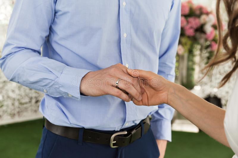 Closeup Of Groom And Bride Holding Hands At Wedding Ceremony. Happy Marriage stock images