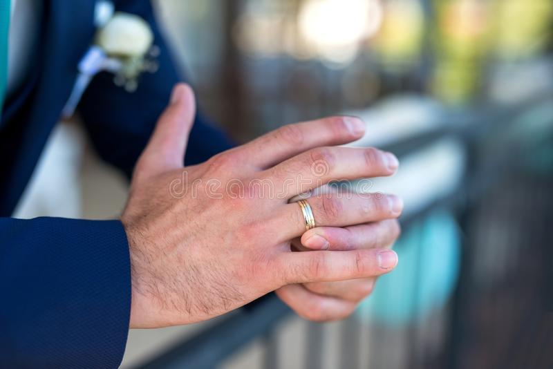 Closeup of groom`s hand and wedding ring. Selective focus stock image