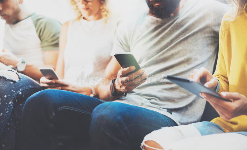 Closeup Group Adult Hipsters Friends Sitting Sofa Using Modern Gadgets.Business Startup Friendship Teamwork Concept stock image