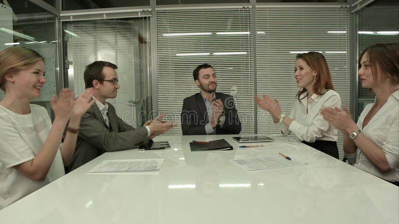 Closeup of group of business people applauding at a meeting royalty free stock photography