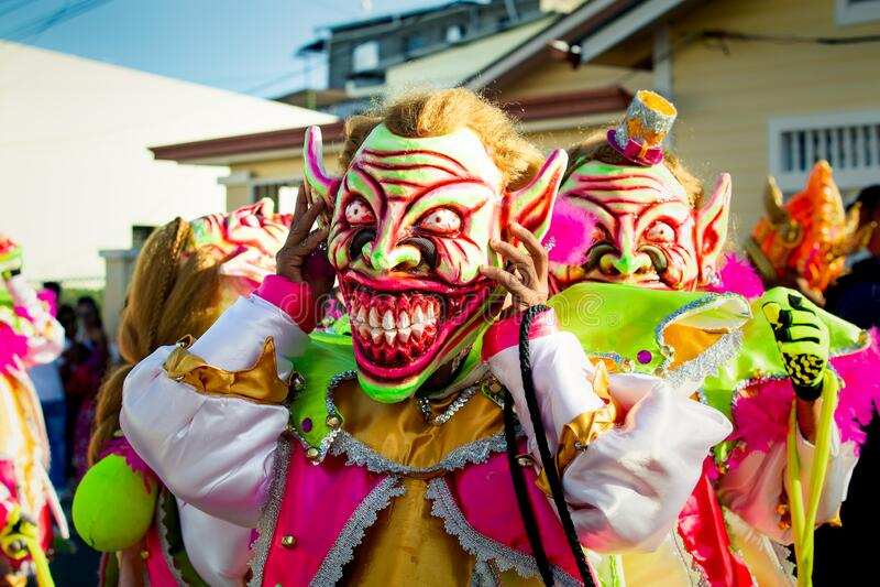 Closeup group of men in scary clowns costumes pose for photo at dominican carnival. Concepcion De La Vega, DOMINICAN REPUBLIC - FEBRUARY 09, 2020: closeup group stock photo
