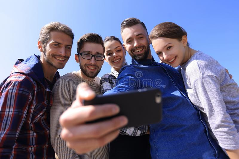 Group of students taking a selfie stock images