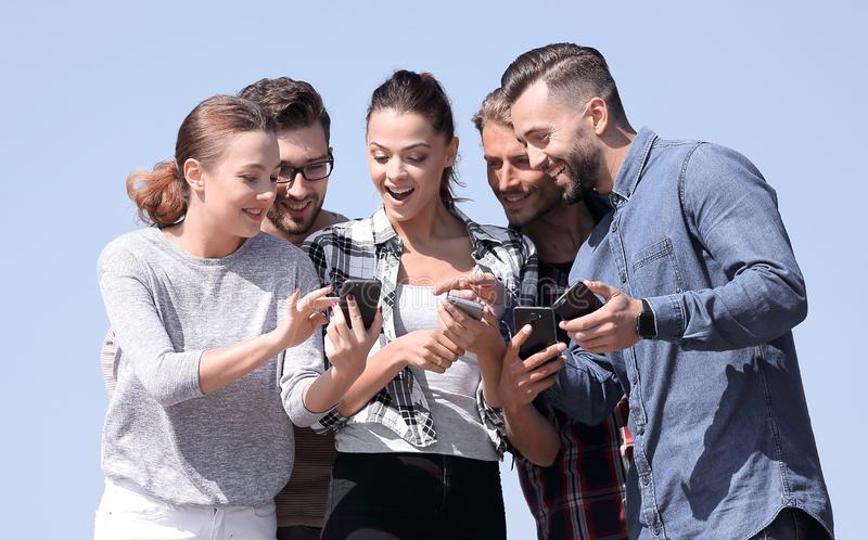 Closeup. the group of students using smartphones. stock image