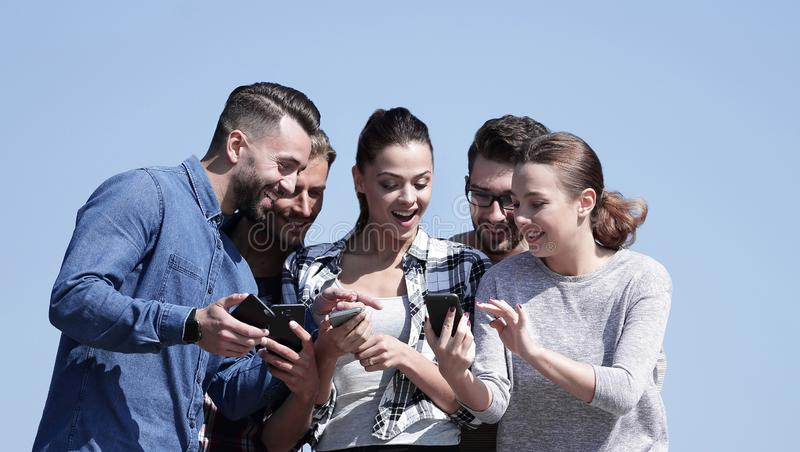 Closeup. the group of students using smartphones. royalty free stock photo