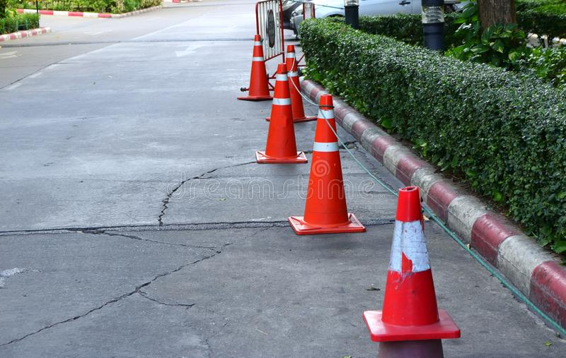 Traffic cones. Closeup of group of traffic cones on street, selective focus, safety concept stock images