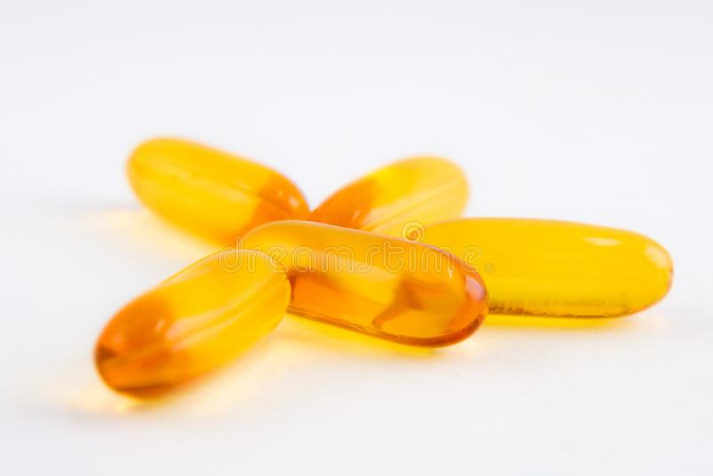 Closeup group of vitamins- supplements or fish oil capsules- healthcare concepts- on white background. stock photo