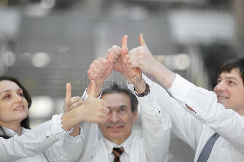 Group of young people hands with thumbs up together expressing positivity, teamwork concepts. stock photography