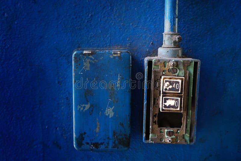 Closeup Grunge Light Switch On Blue Wall Stock Image