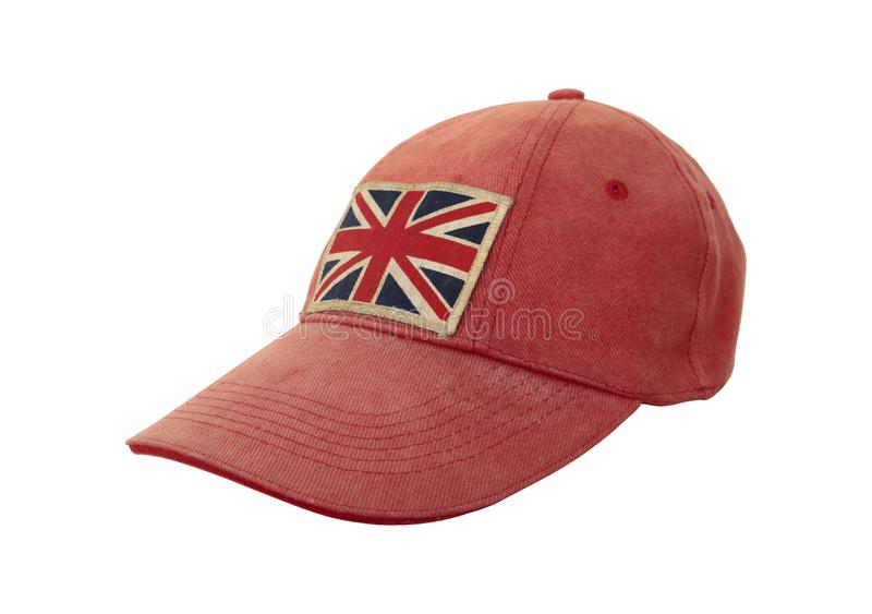 Closeup of grungy weathered cap with British flag on white background. Anglomania concept royalty free stock image