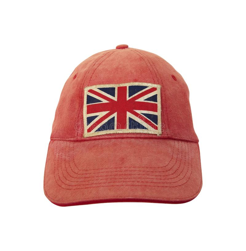 Closeup of grungy weathered cap with British flag on white background. Anglomania concept stock photos