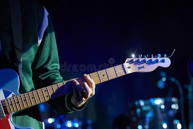 Closeup of guitarist with guitar. stock photo