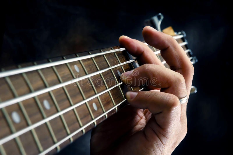 Closeup of guitarist hand playing guitar