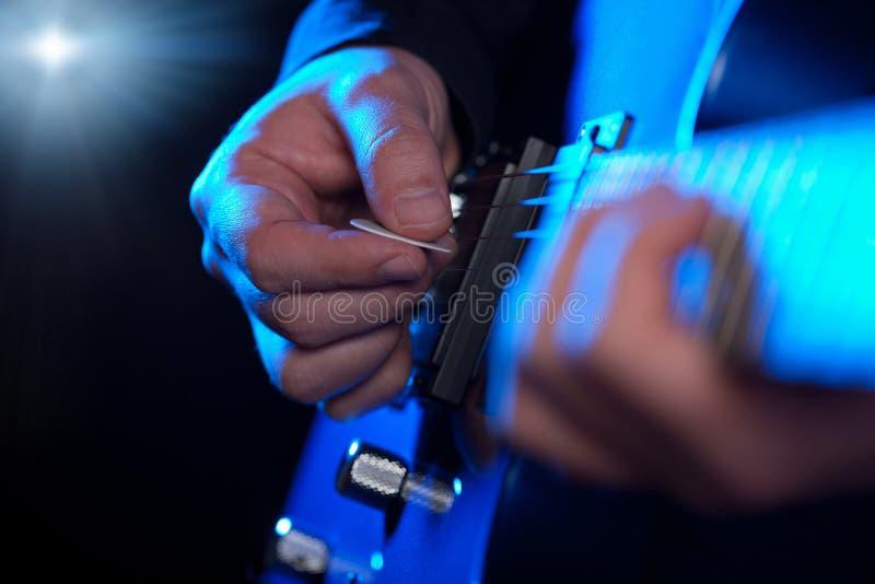Closeup of guitarist hands royalty free stock photo