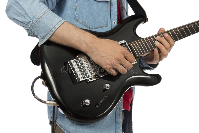 Closeup of a guitarist's hands playing e-guitar stock images