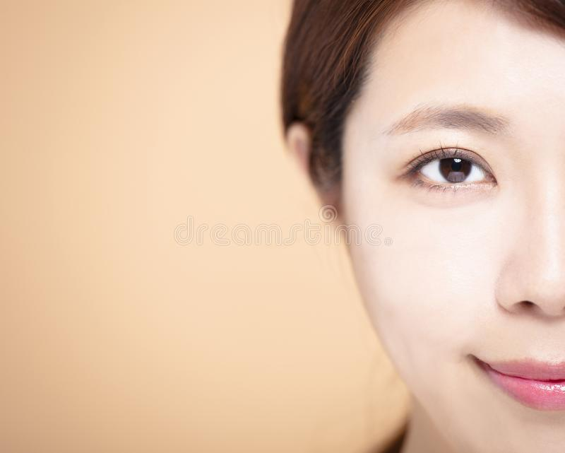 half Beauty face of the young woman royalty free stock images