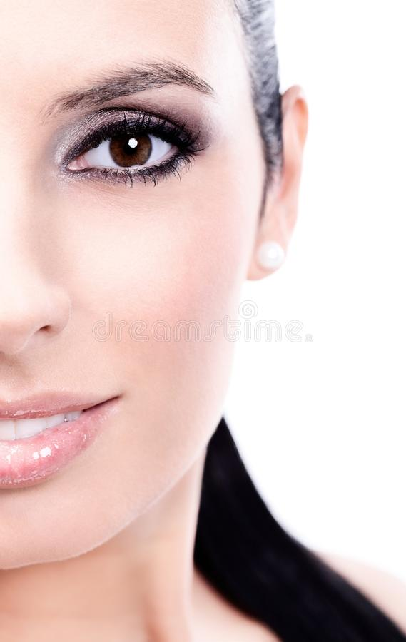 Closeup half portrait of beautiful smiling woman royalty free stock image