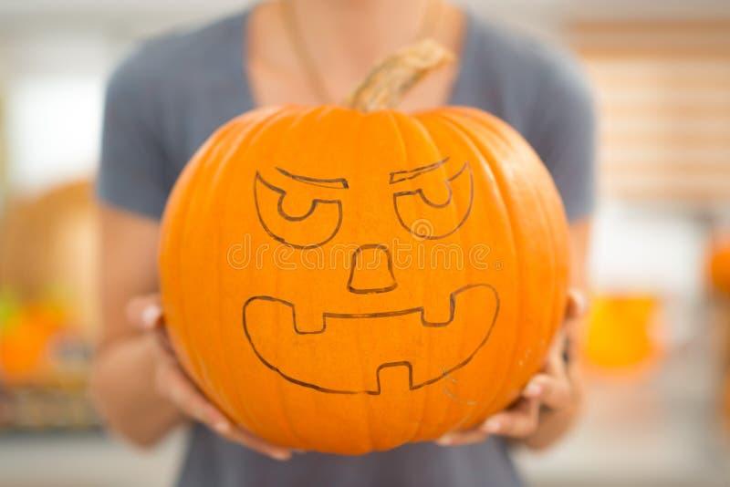 Closeup. Halloween pumpkin Jack-O-Lantern in womans hands stock photos