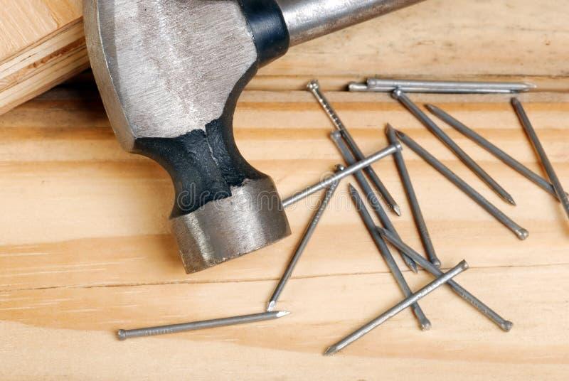 Closeup Of Hammer And Nails Royalty Free Stock Photography