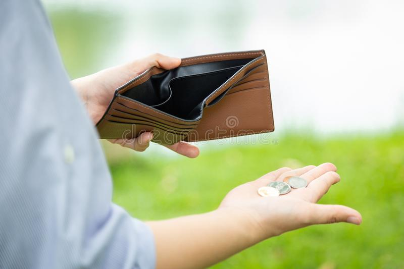 Closeup hand of asian businesswoman holding her wallet,hand open an empty wallet,spend money extravagantly,extravagant people. Never save money,bad economics royalty free stock photography