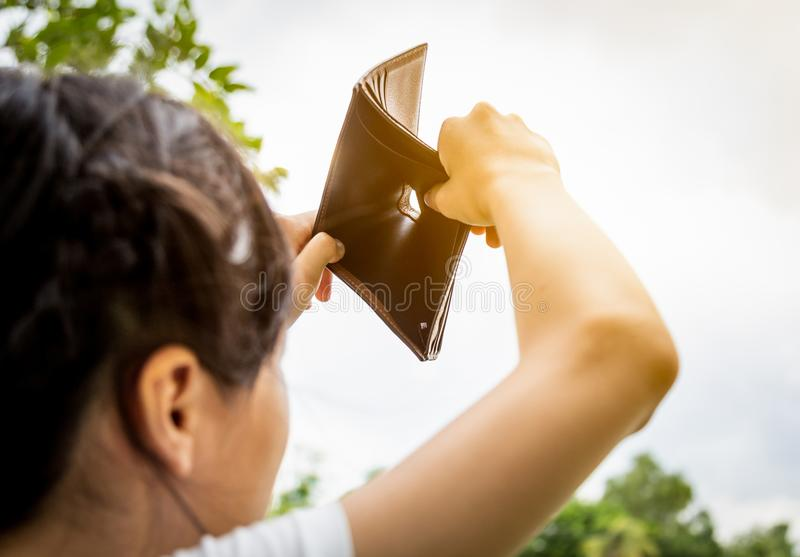 Closeup hand of asian child girl shows her wallet,hand open an empty wallet, no pocket money,spend money extravagantly,extravagant. Closeup hand of asian child royalty free stock images