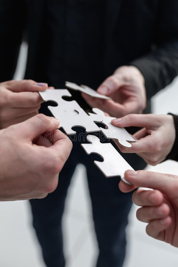 Closeup hand connecting jigsaw puzzle with, business solutions, royalty free stock images