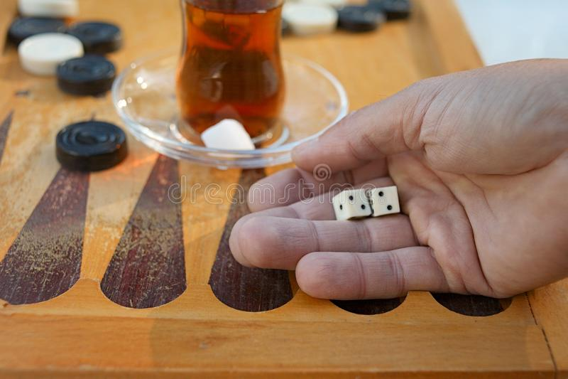 Hand dropping dice royalty free stock photography
