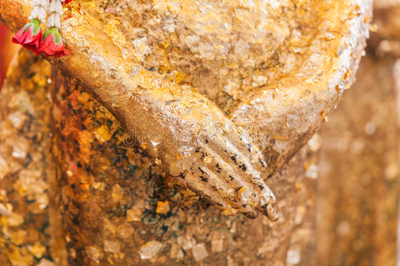Closeup hand of gilded ancient buddha statue. In thai temple stock photos