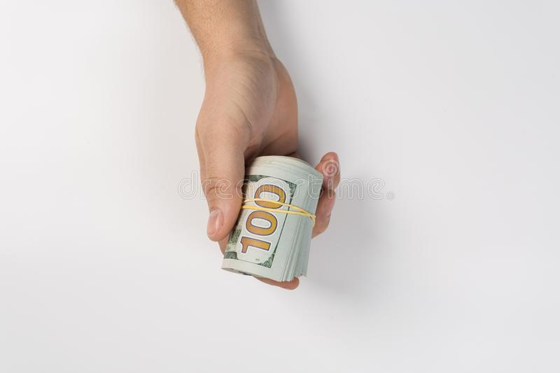 Closeup hand giving money to another hand  on white background. bribe royalty free stock photo