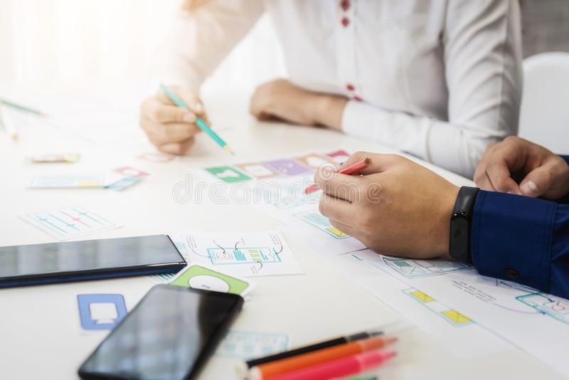 Closeup hand of graphic designer working about wireframe application design in office. User experience concept stock images