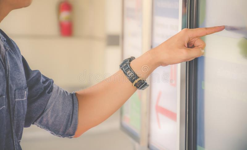 Closeup hand of a man pointing finger to screen  large display of a orders food in the touch screen terminal or in the electronic. Menu in the restaurant stock image