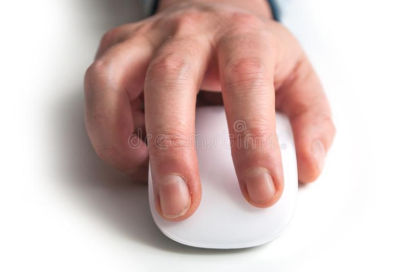 Hand of man on white mouse on pink background royalty free stock photos
