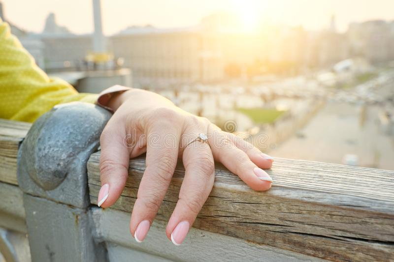Closeup of hand mature 40, 45 year old woman, nails with manicure, ring on finger, outdoor royalty free stock photo