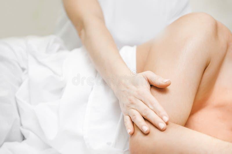 Closeup hand professional back massage thai passive yoga beauty spa.  stock photo