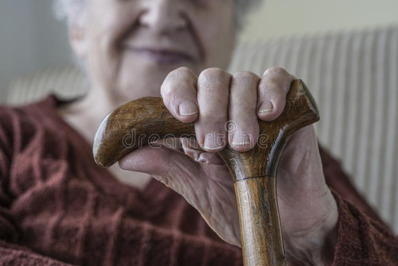Closeup hand of a senior woman holding stick royalty free stock photos