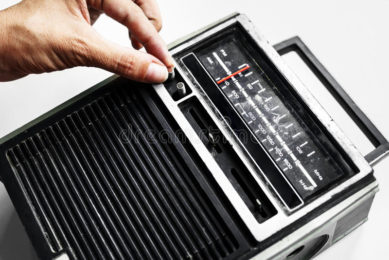 Closeup of hand tuning classic retro radio transistor royalty free stock photo