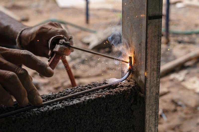 closeup hand welding metal in construction site stock photos