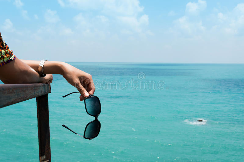 Closeup of hand women hold sunglasses royalty free stock photo
