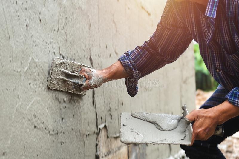 closeup hand of worker are plastering royalty free stock images