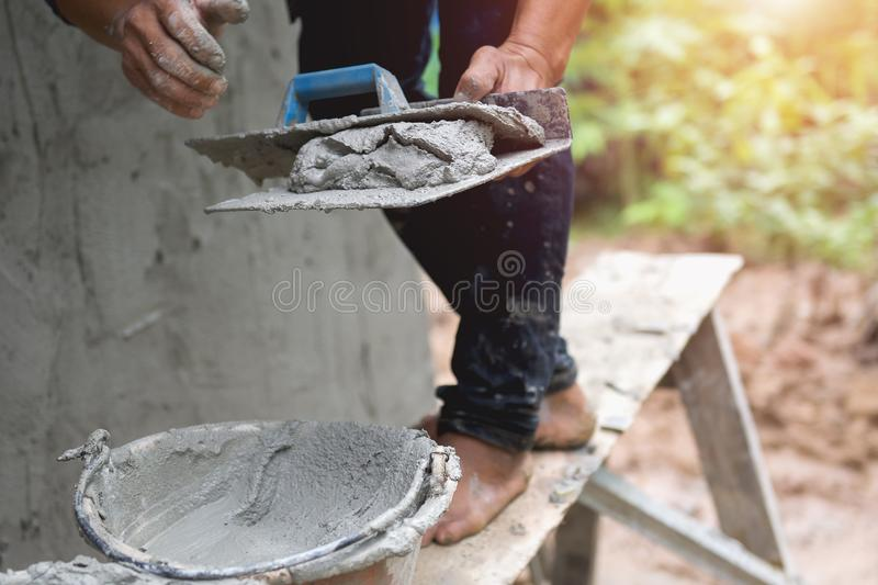 closeup hand of worker are plastering royalty free stock photos
