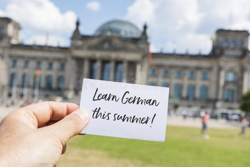 Text learn german this summer, in berlin, germany stock images