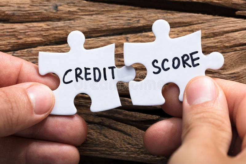 Hands Connecting Credit Score Jigsaw Pieces royalty free stock images