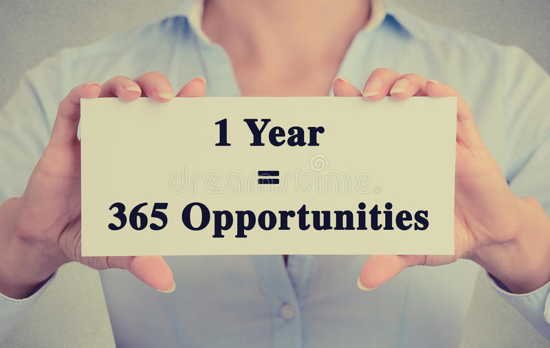 Closeup hands holding sign one year 365 opportunities message stock image