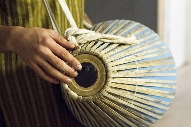 Closeup of hands on indian drum, musical accompaniment in yoga studio. Selective focus royalty free stock photography