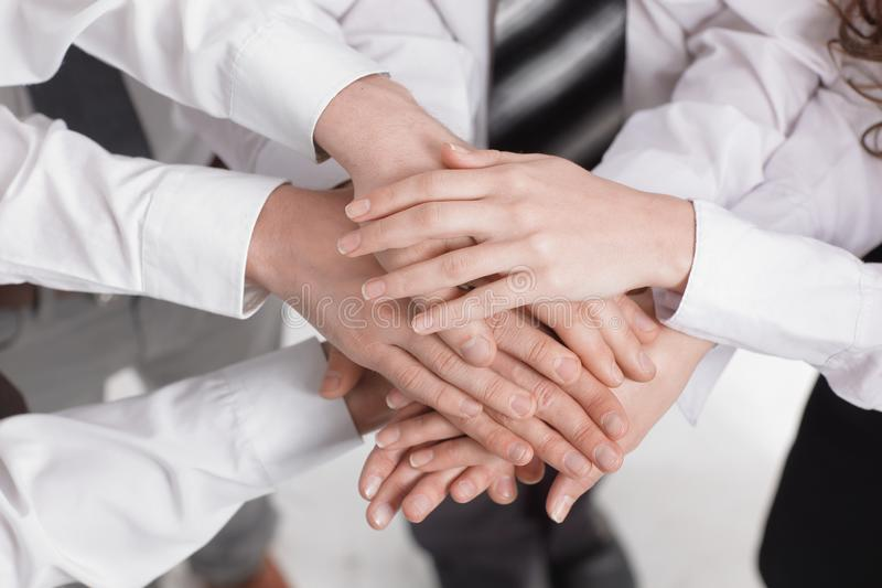Closeup .the hands of the members of the business team put together stock photos