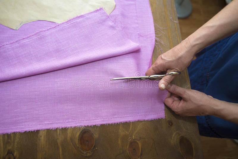 Closeup of hands of seamstress. Working stock photo